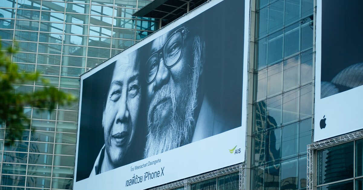 old man and woman on billboard