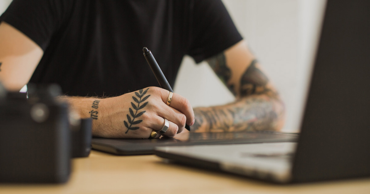 man holding sketch pen